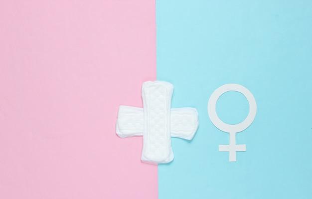 Female gender symbol, pads on pastel background