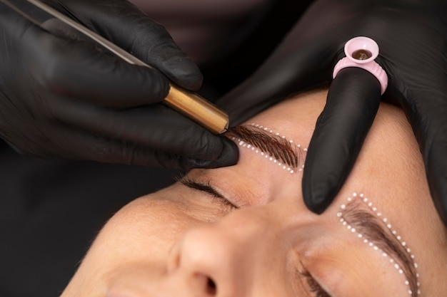 Female going through a microblading treatment