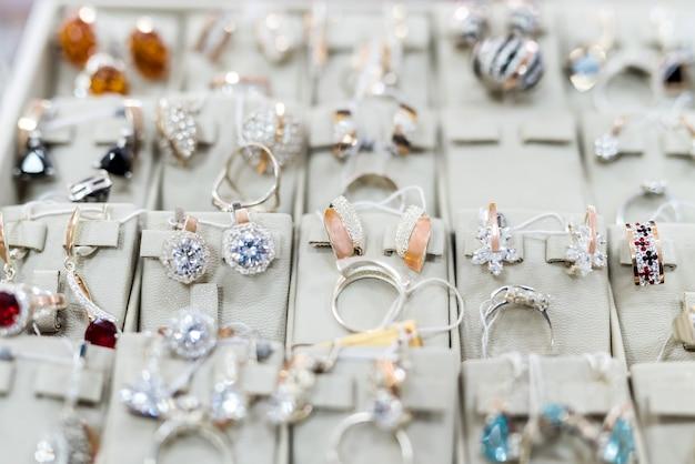 Female golden accessories in jewellery shop showcase
