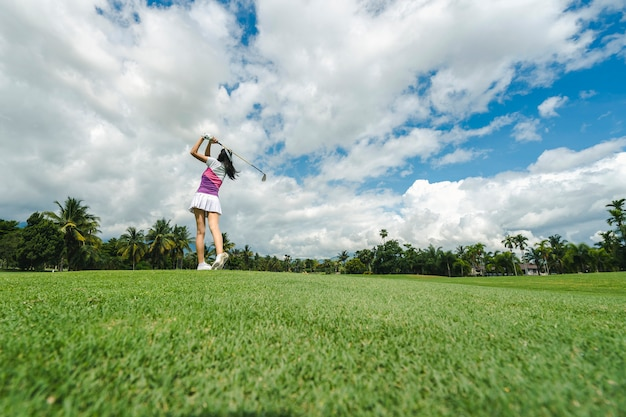 Female golf player playing golf in professional golf course