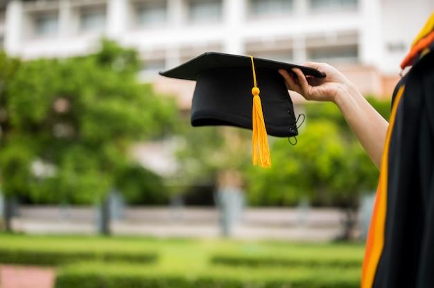 Female graduates celebrate the university graduation day