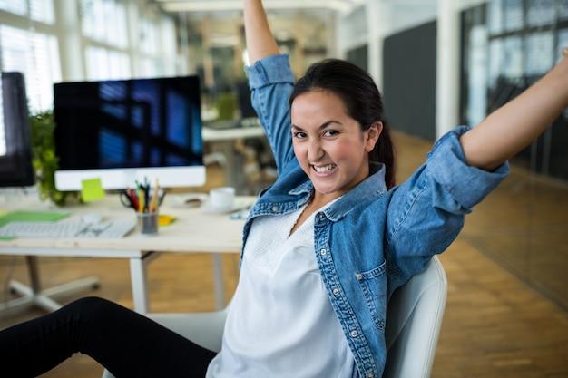 Female graphic designer in cheerful mood