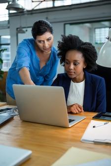 Female graphic designers using laptop