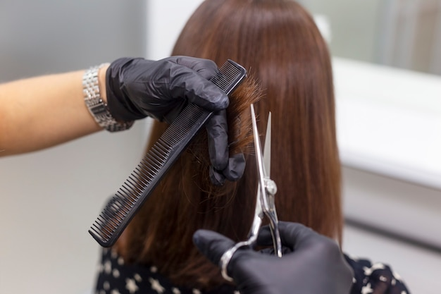 Female hairdresser makes a haircut. professional hairdressing tools, equipment.