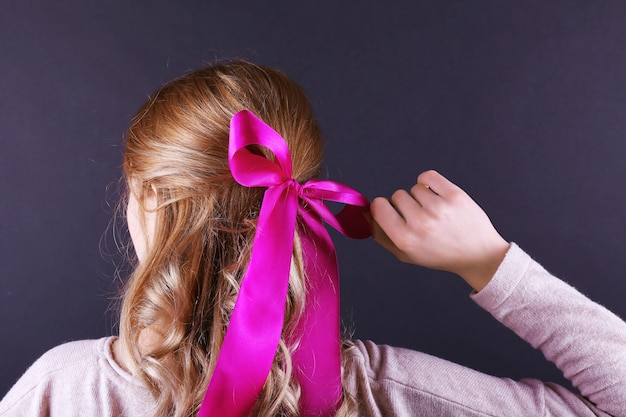 Female hairstyle with color ribbon