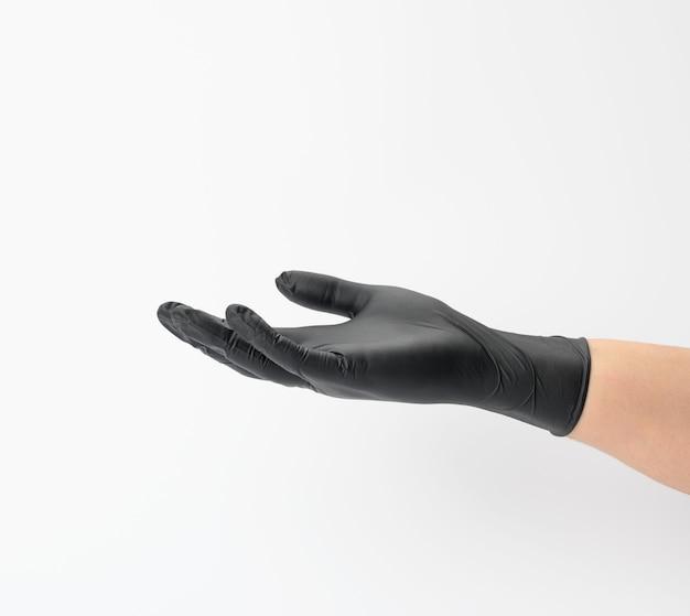 Female hand in a black latex glove, palm open