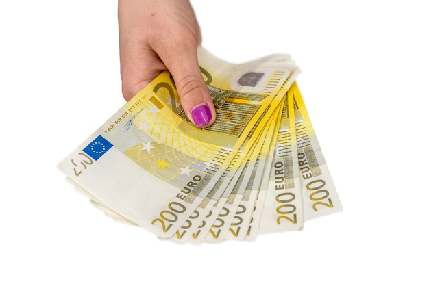 Female hand hold 200 euro banknotes isolated on white