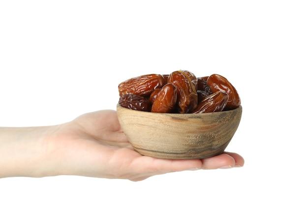 여성의 손을 잡고 말린 날짜, 흰색 배경에 고립의 그릇