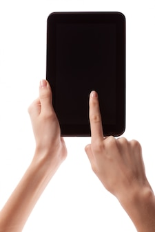Female hand holding android digital tablet computer with black empty screen and copyspace, isolated.