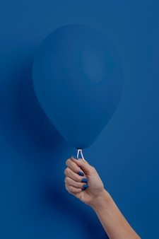 Female hand holding balloon