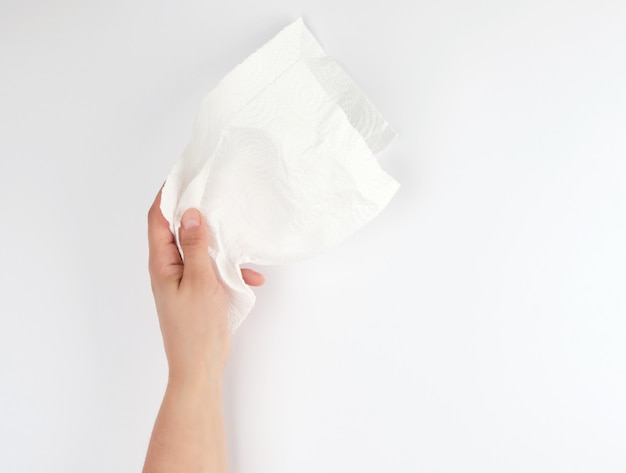 Female hand holding a clean white paper napkin