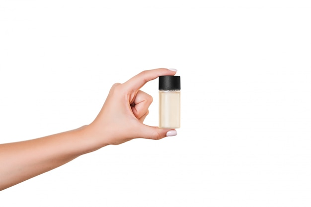Female hand holding cream bottle of lotion