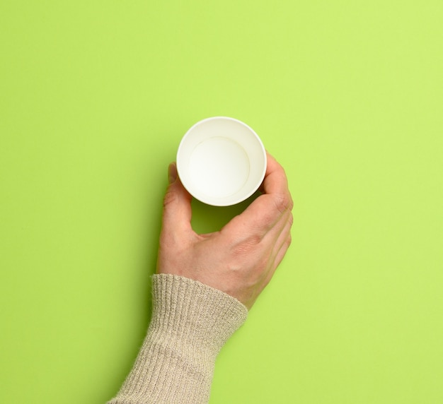 Female hand holding empty paper disposable cup, concept eco-friendly, zero waste , top view