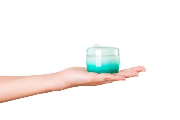 Female hand holding lotion cream