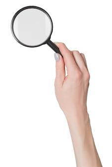 여성의 손을 잡고 돋보기 흰색 배경에 격리합니다.