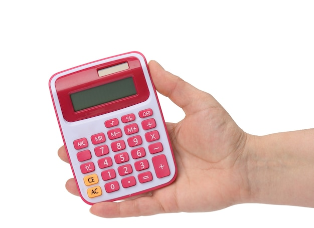 Female hand holding a pink calculator on a white surface, close up