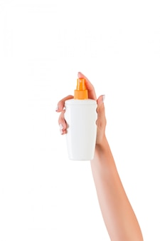 Female hand holding sunscreen lotion