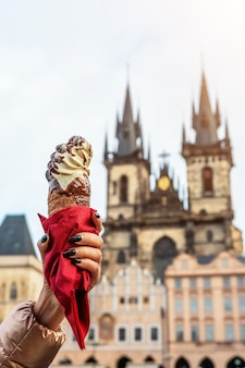 Female hand holding traditional trdelnik czech cookie