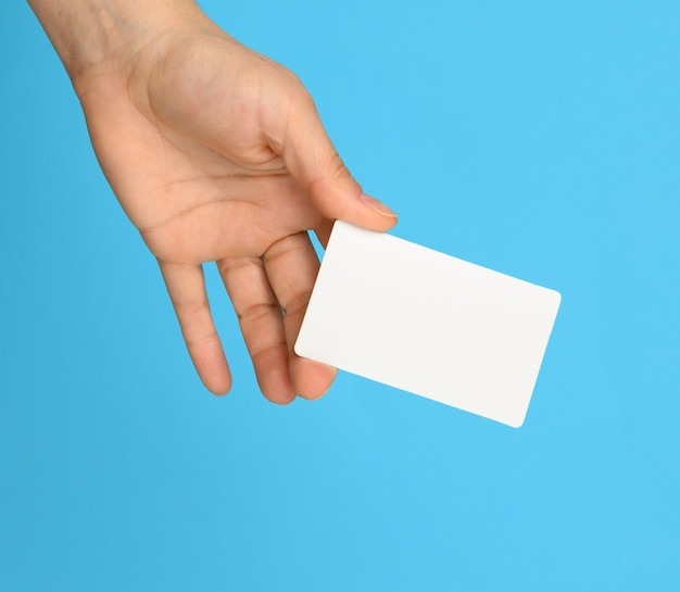 Female hand holding a white black business card