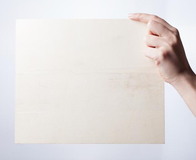 Female hand holds blank billboard