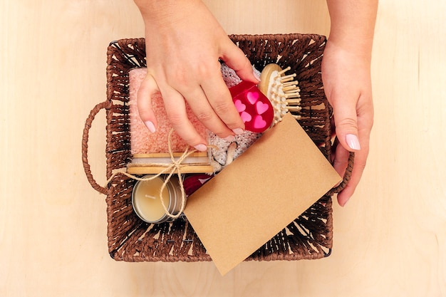 Female hand holds care box set of eco - friendly cosmetics