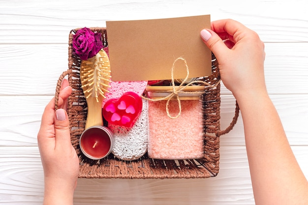 Female hand holds care box set of eco-friendly cosmetics