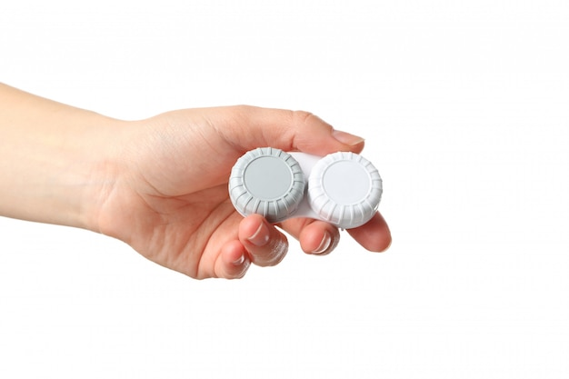 Female hand holds case for contact lenses, isolated on white surface