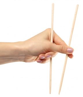 Female hand holds chopsticks