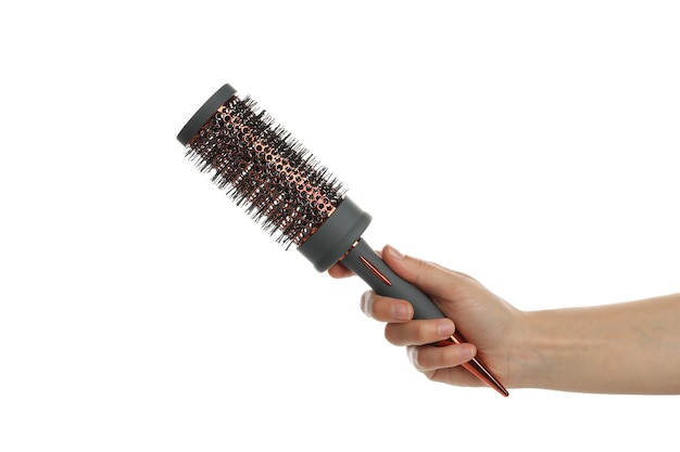 Female hand holds hairbrush, isolated