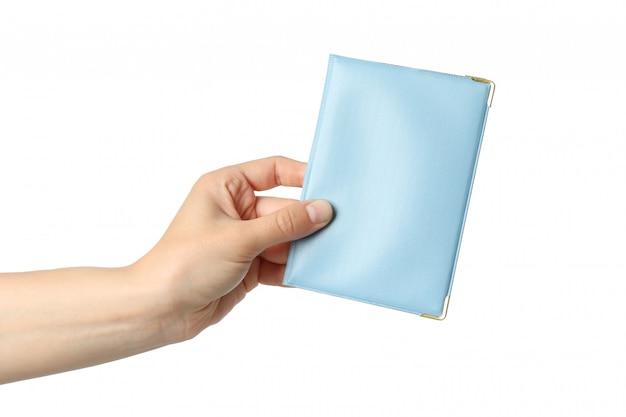 여성 손 보유 여권 커버, 흰색 절연