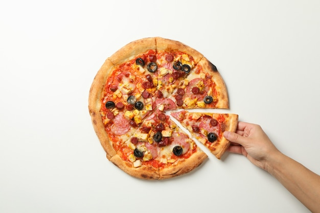 Female hand holds tasty pizza top view