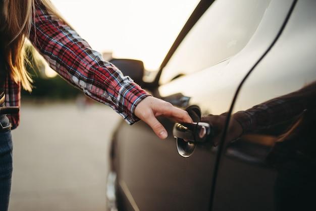 Female hand open car door, driver beginner concept