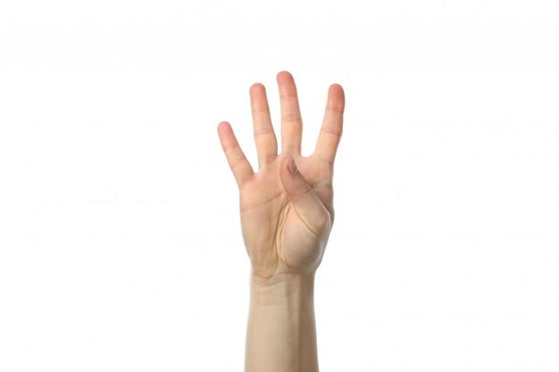 흰색 표면에 고립 된 세 손가락을 보여주는 여성 손