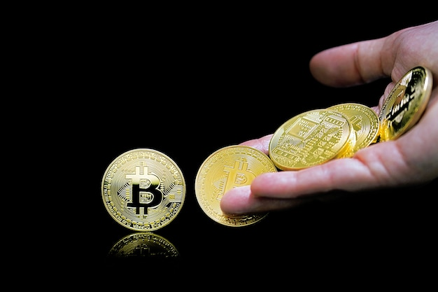 Female hand throws gold bitcoin. bitcoins. bitcoins and new virtual money concept. bitcoin is a new currency.