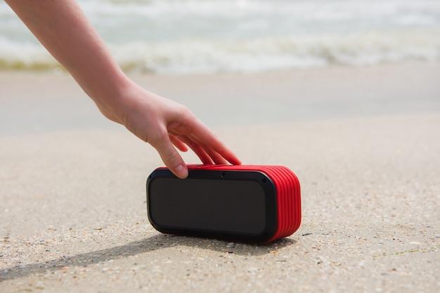 Female hand touch portable speaker
