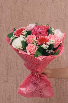 Female hand with beautiful gentle festive bouquet