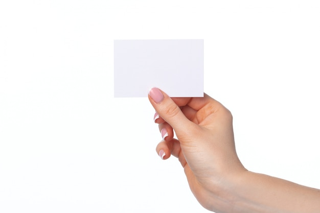 Female hand with blank white business card isolated on white