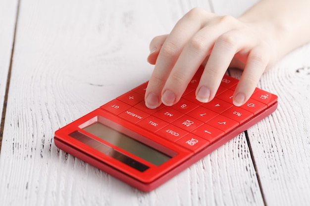 Female hand with calculator