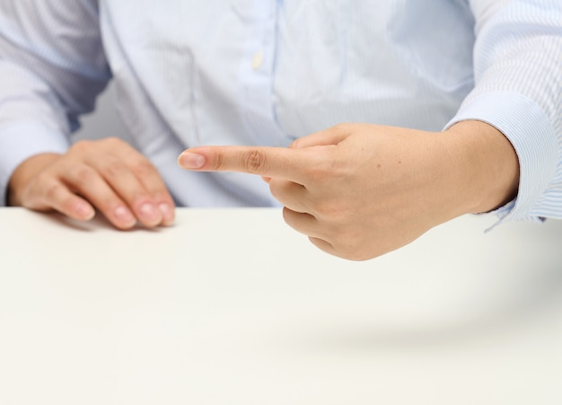 Female hand with forefinger. part of the body points to the side, direction to focus