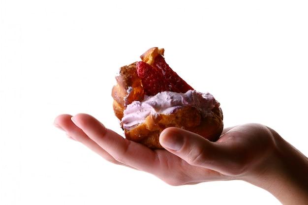 Female hand with fruitcake