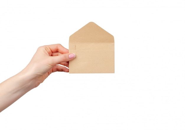 Female hand with manicure holding open beige envelope
