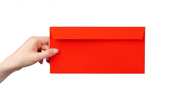 Female hand with manicure holding red envelope