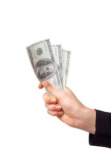 Женская рука с деньгами, изолированные на белом фоне