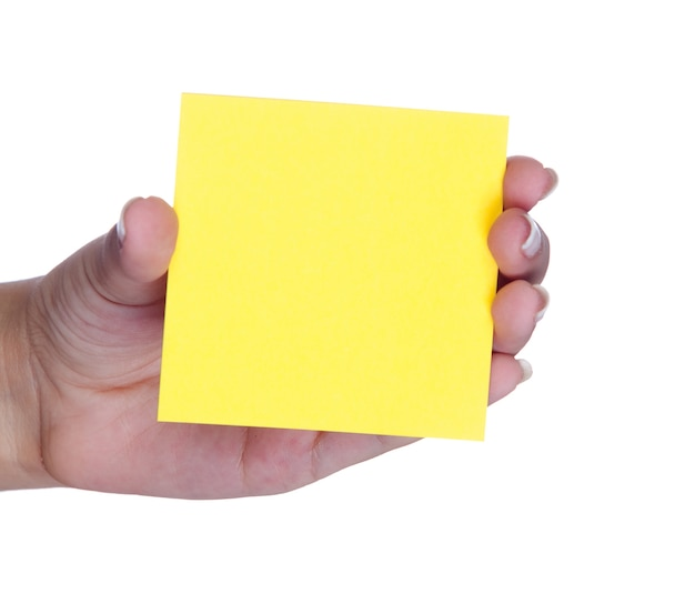 Female hand with a yellow post-it isolated on white background