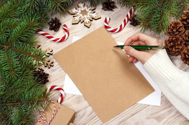 Female hand writing a christmas letter
