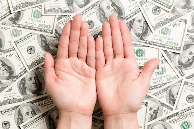 Female hands on dollar