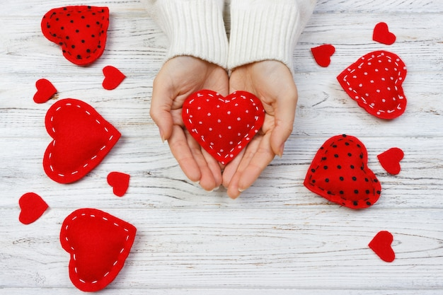 Female hands giving red heart. valentine day