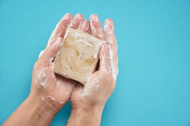 In female hands handmade soap hands in foam