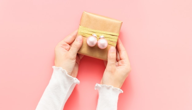 Female hands hold christmas gift box
