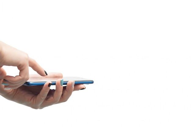 Female hands hold a smartphone